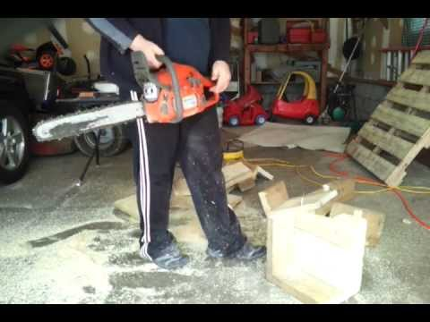 Husqvarna chainsaw 445 Cutting up a skid in garage 45.7cc 2 stroke