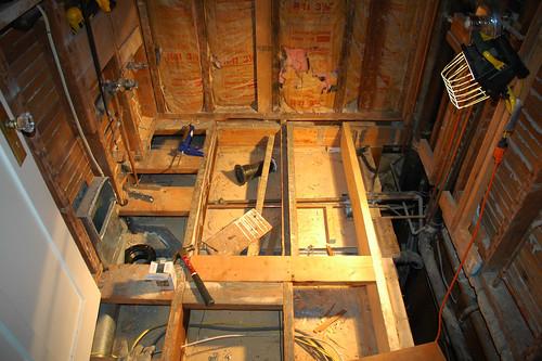 raising subfloor height,how to raise subfloor,how to raise subfloor height,how to raise subfloor for laminate,raised subfloor,raised subfloor over concrete,building a raised subfloor over concrete,how to build a raised subfloor in a garage,raising subfloor for vinyl plank,raised subfloor for basement